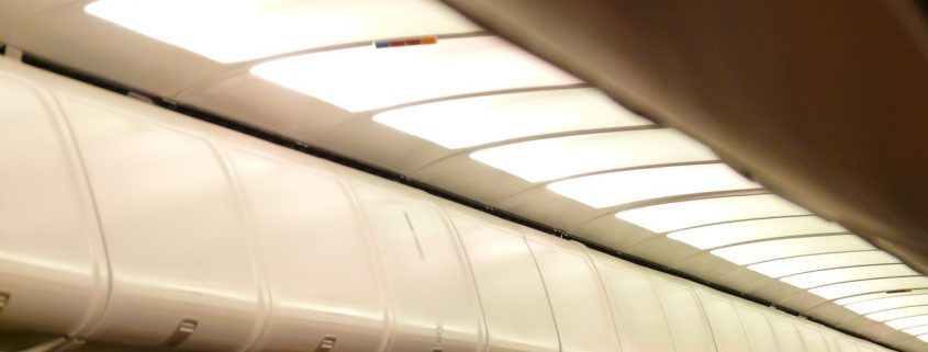 Use the overhead locker on the other side of the aisle